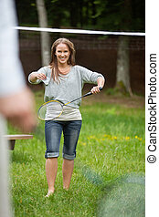 Young Female Playing Badminton - Happy young female in...