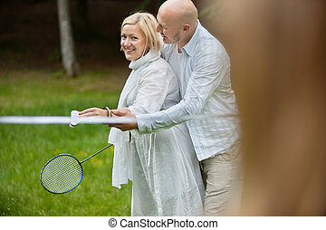 Couple Playing Badminton Together