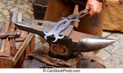 blacksmith forged anvil hammer man beating traditional shape...