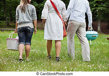 Friends On a Weekend Picnic - Rear view of friends in casual...