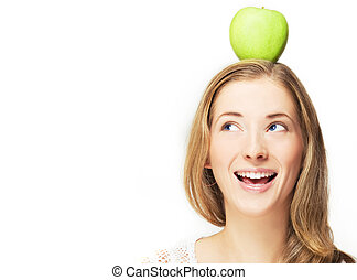 apple on her head - portrait of positive woman with apple on...