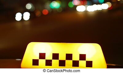 Illuminated Taxi Sign - Illuminated taxi sign at night in...