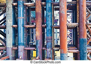 metal rust pipes in old bridge