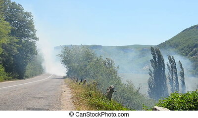 Road in to smoke from a forest fire