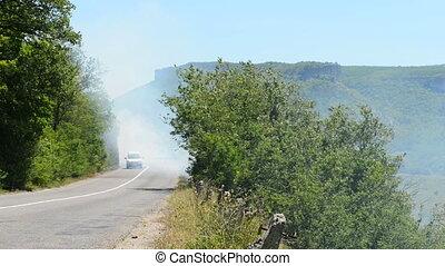 Cars go through the smoke