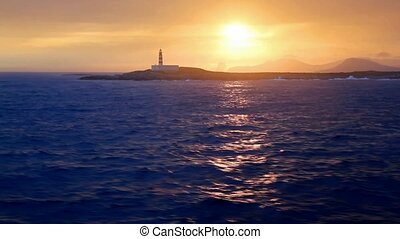 boating from Ibiza island on sunset over a boat in...