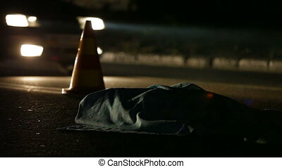 Road Accident Victim - Auto accident on the night city road,...