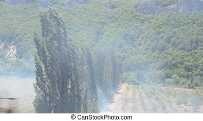 Drive on car through a forest fire - Passage through a...
