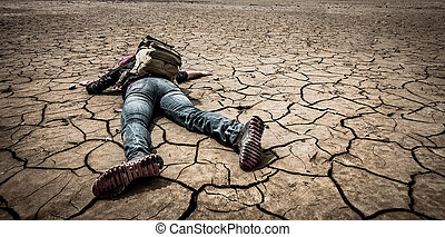 person lays on the dried ground - traveller lays on the...