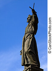 Monument of San Francesco on blue sky