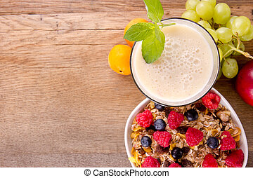 Healthy breakfast on wooden table, focused on drink.