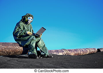 Scientist with a laptop on chemically contaminated area - A...