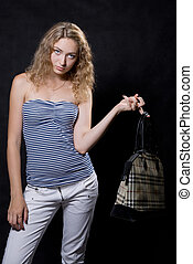Beautiful blonde with a bag on a finger