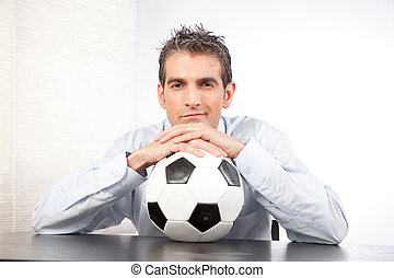 Businessman With Football At Work - Businessman with...