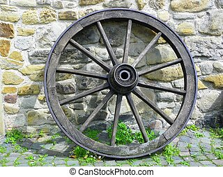 Wooden wagon wheel  - Image of a wagon wheel