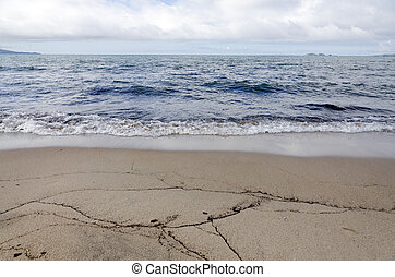 Lake Superior Shoreline. Waves come to a shore of sand