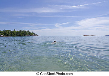 Superior Lake - Green and blue water of Superior Lake under...