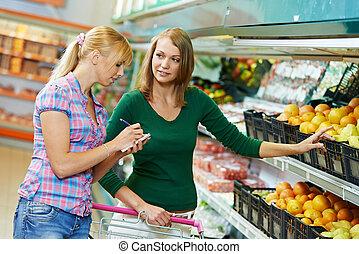 woman shopping fruits - woman choosing fruits during...