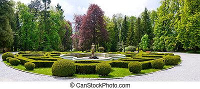 Formal garden - And ornamental fountain in a formal garden