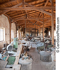 Clutter in the attic - Old factory attic with lots of old...