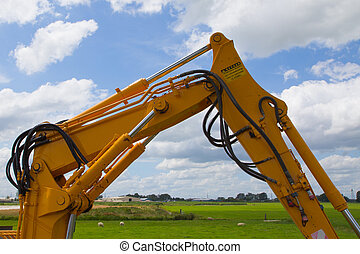 hydraulic excavator - the articulation of a yellow mini...