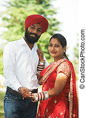 Happy indian young adult married couple - Happy Smiling...