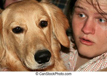 Teen Talking To Bored Dog - Closeup of a teenage boy talking...