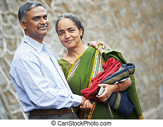 Happy indian adult people couple