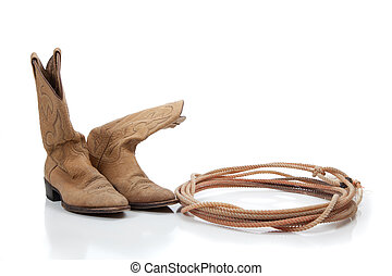 Pair of brown cowboy boots and a lariat rope on white background