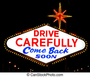 "The reverse of the Las Vegas sign reading ""Drive Carefully""..."