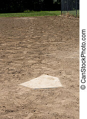 Home plate with first base in the background