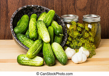 Pickles with jars of pickles - Pickles or cucumbers with...