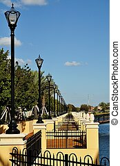 Lamposts Along a Walkway - A row of lamp osts along a...