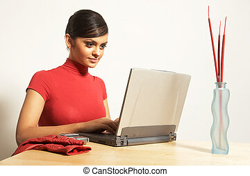 business woman with laptop and phone - attractive business...