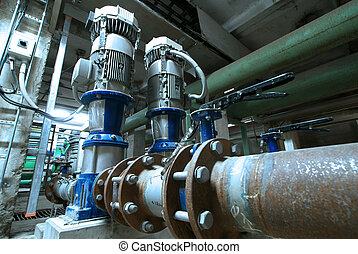 Equipment, cables and piping as found inside of industrial...