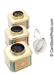 tea boxes with tea strainer - object on white - kitchen...