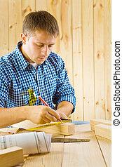 carpenter with pencil