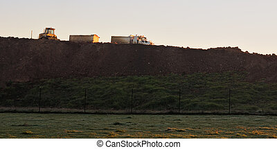 Bulldozer and truck at earthworks - Bulldozer and truck at...