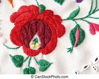 Embroidery close-up with red flower