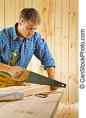 worker works with handsaw