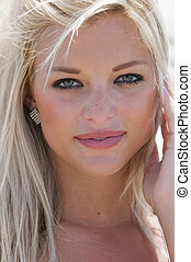 Attractive green eyed woman looking directly into the...