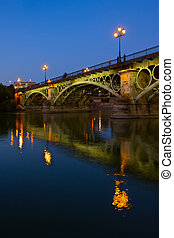 Triana Bridge, Seville, Spain - Triana Bridge illuminated at...