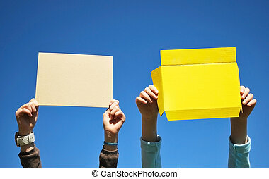 Blank protest placards - Human hands holding blank paper...