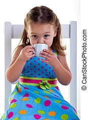Drinking coffee - She is sitting on the chair carefully...