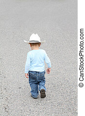 Small Cowboy - Toddler cowboy walking down the street...