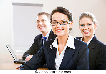 Female leader - Image of female leader with her business...