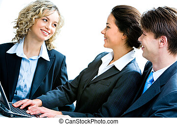 Interview - Portrait of business people looking at woman at...