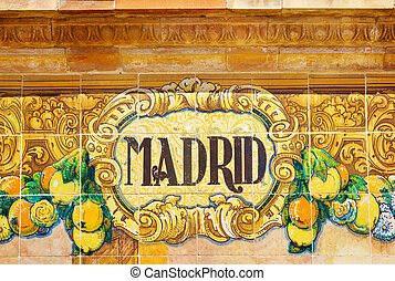 Madrid sign over a mosaic wall - ceramic decoration on...