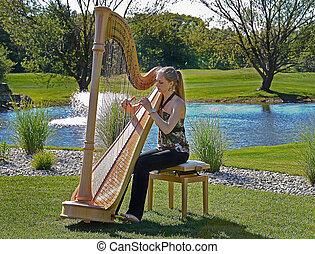 jovem, mulher, tocando, harpa