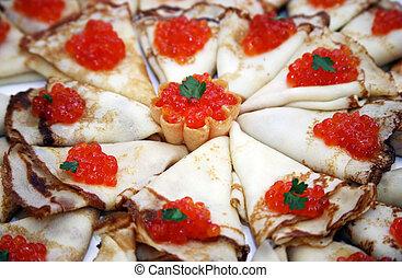 Pancakes with caviar - Pile of pancakes and caviar on a...
